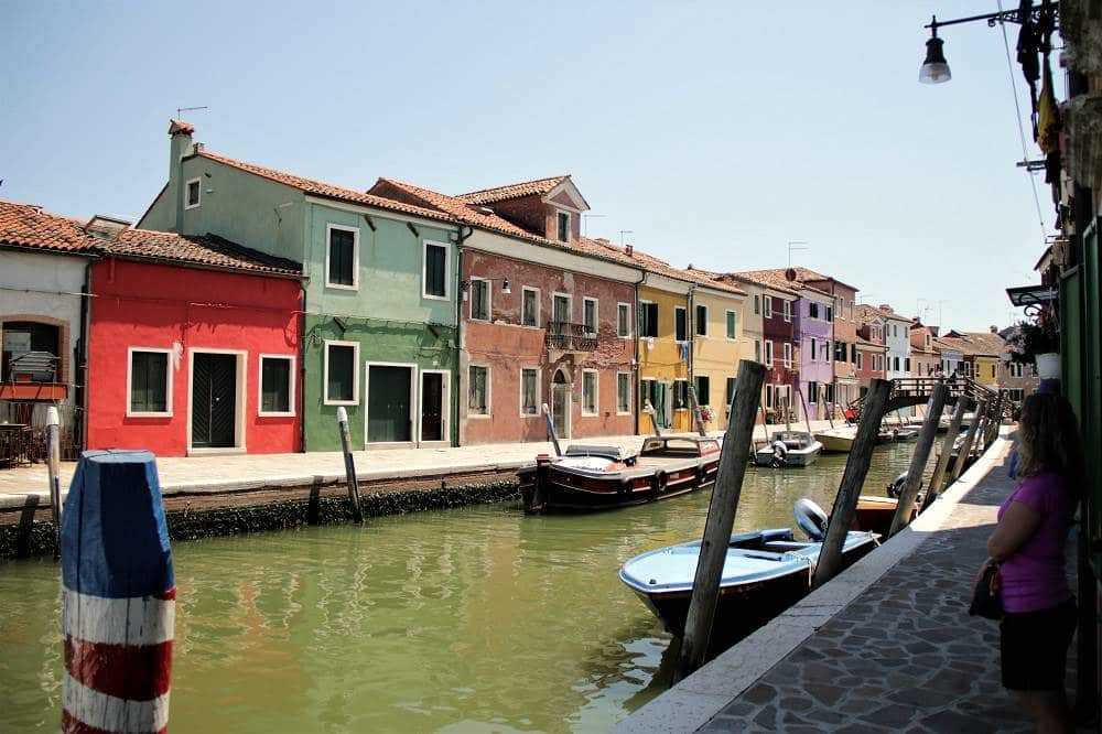 Colorful houses line a canal