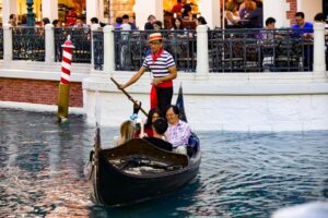 gondolier on gondola in the canals of the Venetian hotel