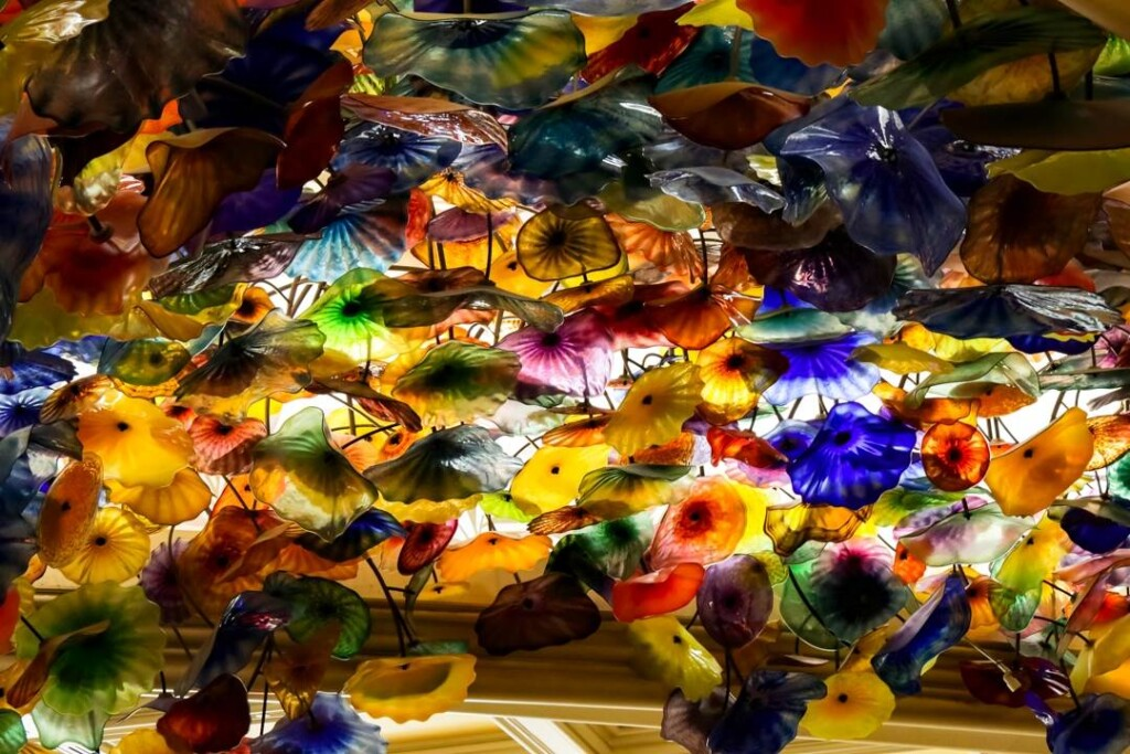 hundreds of colorful glass flowers suspended from the ceiling
