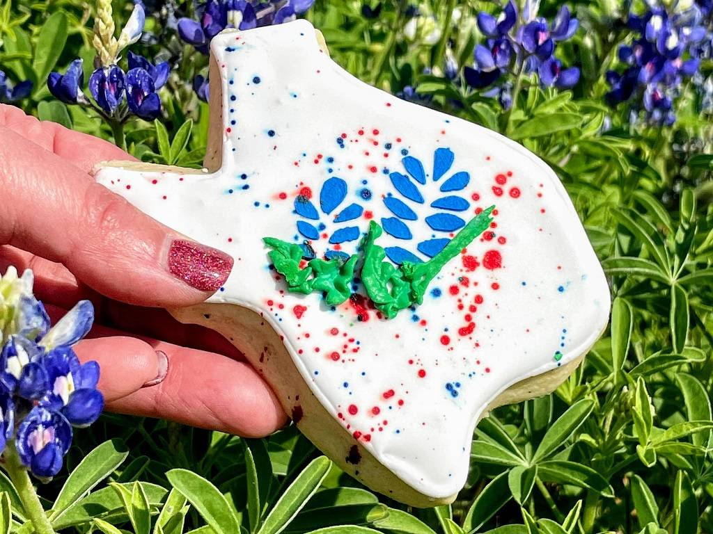Highland Lakes-Texas shaped cookie in bluebonnets
