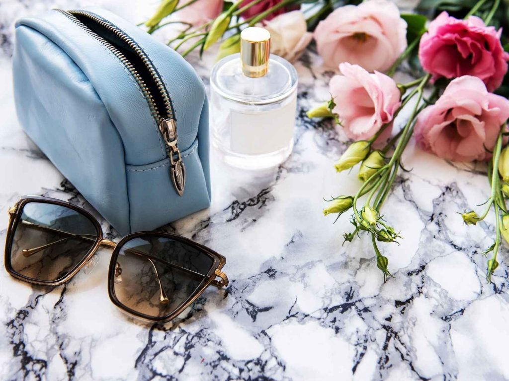 cosmetic bag and sunglasses-gifts for travel lovers