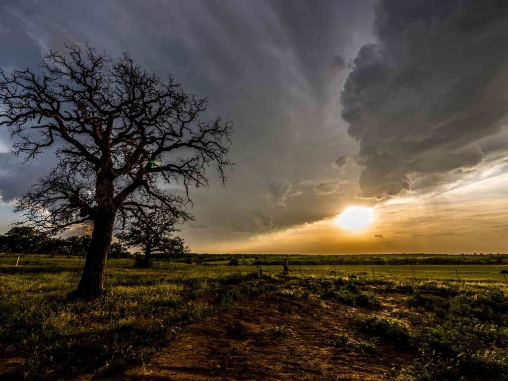 sunset over field-Texas glamping