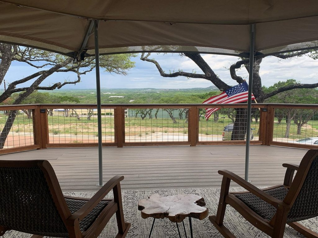 porch of glamping tent looking out onto field
