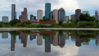 lake with the Houston skyline reflecting in it