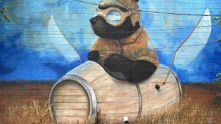 mural of a bear in wine barrel in Ruidoso