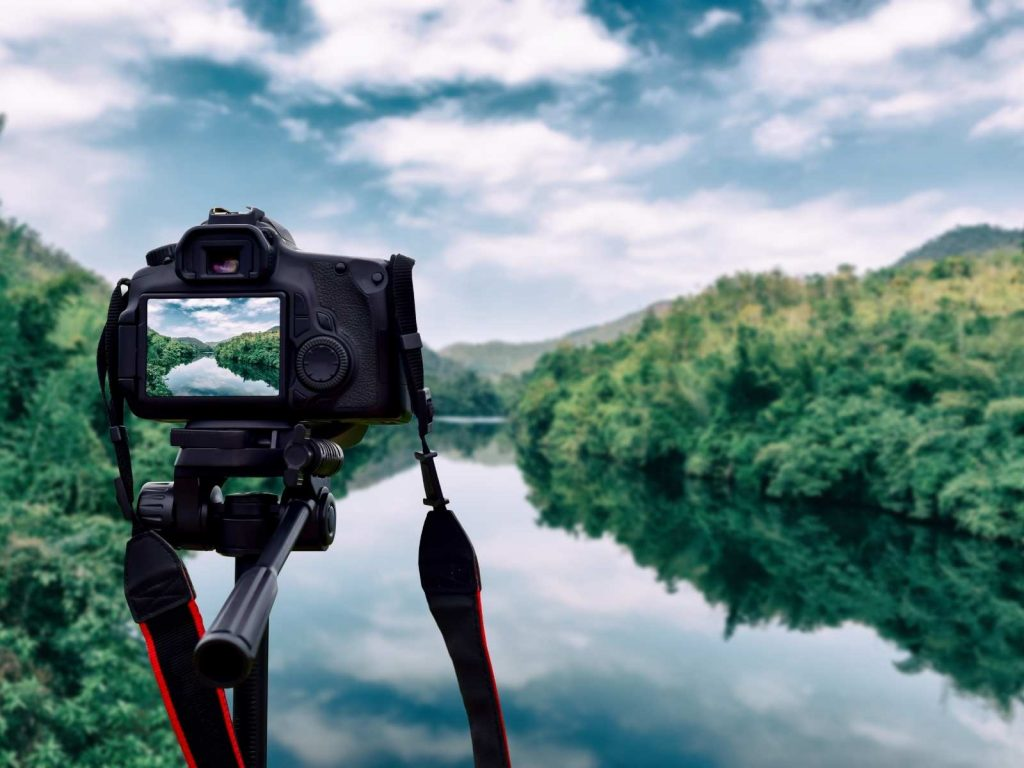 camera on a tripod taking a picture of a river